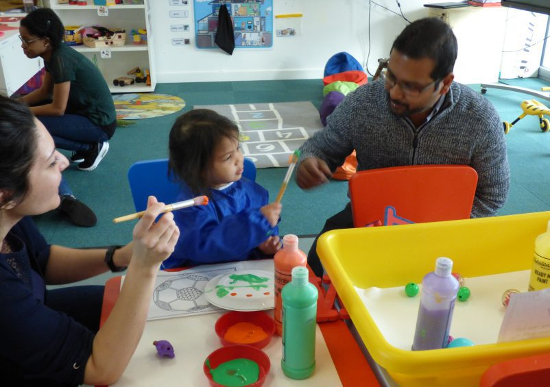 A parent and child at Early Years