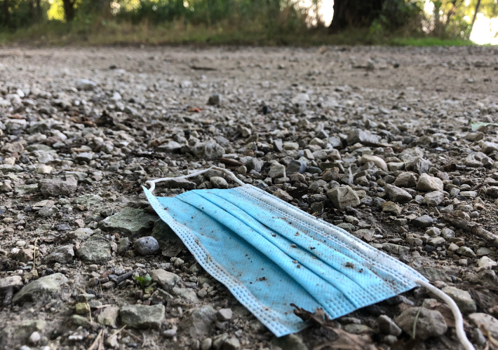 Disposable mask on the ground