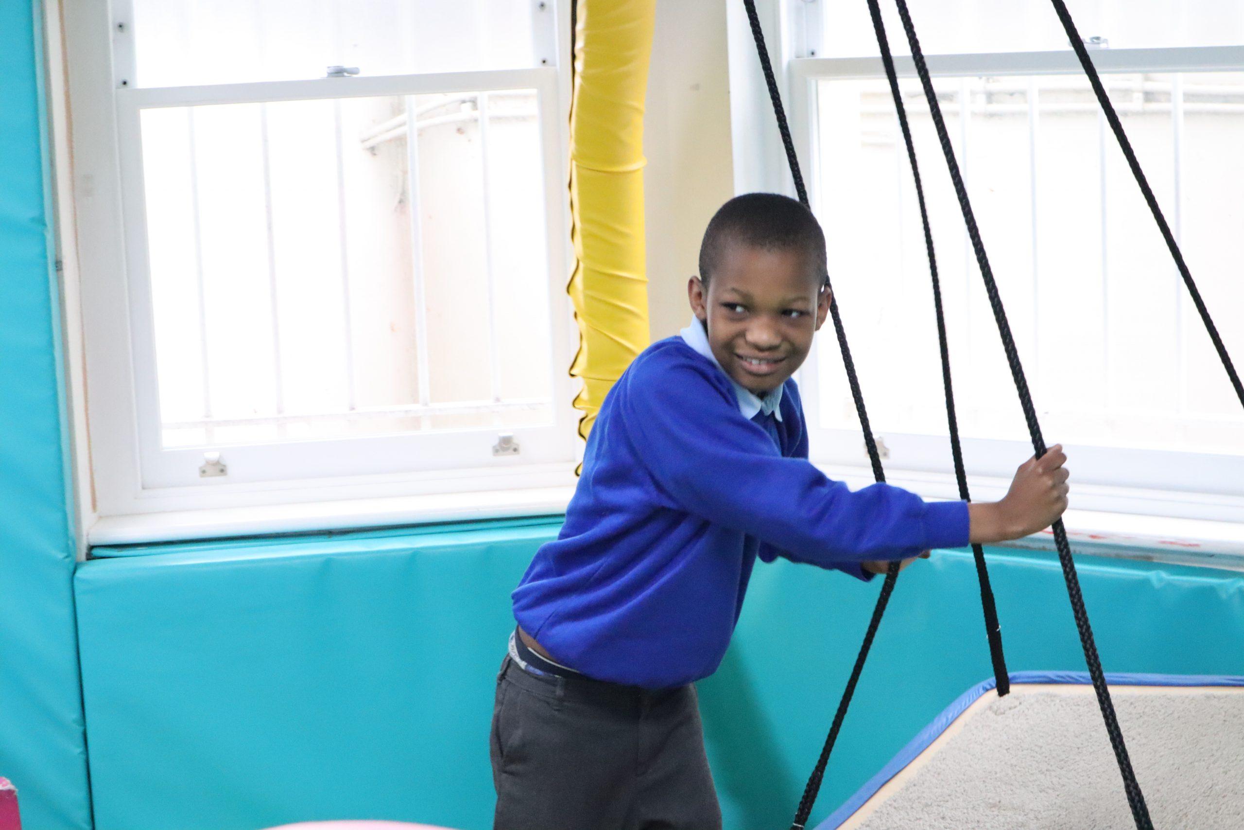 Boy on sensory swing